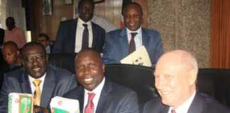 File photo of Kenyan Agriculture CS Willy Bett [C], PS Richard Lesiyampe and Cereal Millers Association Nick. Photo / The Star Kenya