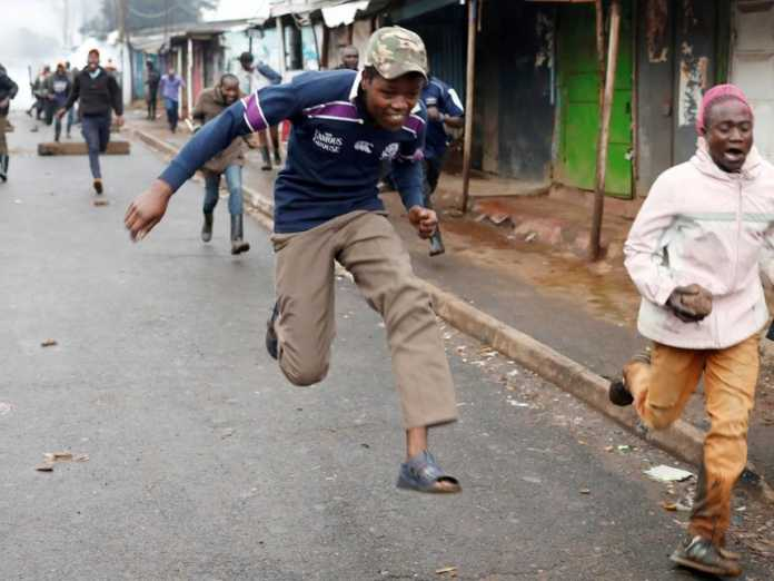 Nairobi Man Runnning from riot police