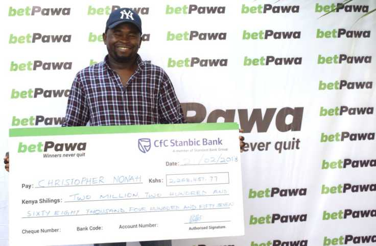Betting Winner Chris Nonah with cheque on betPawa