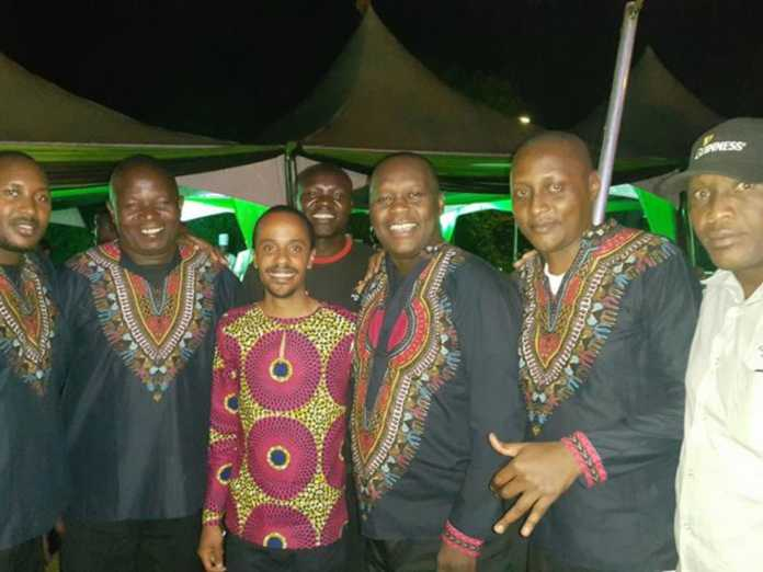Jmo hangs out with Kayamba Africa. The late Shadrack Ndetto is on the far left.