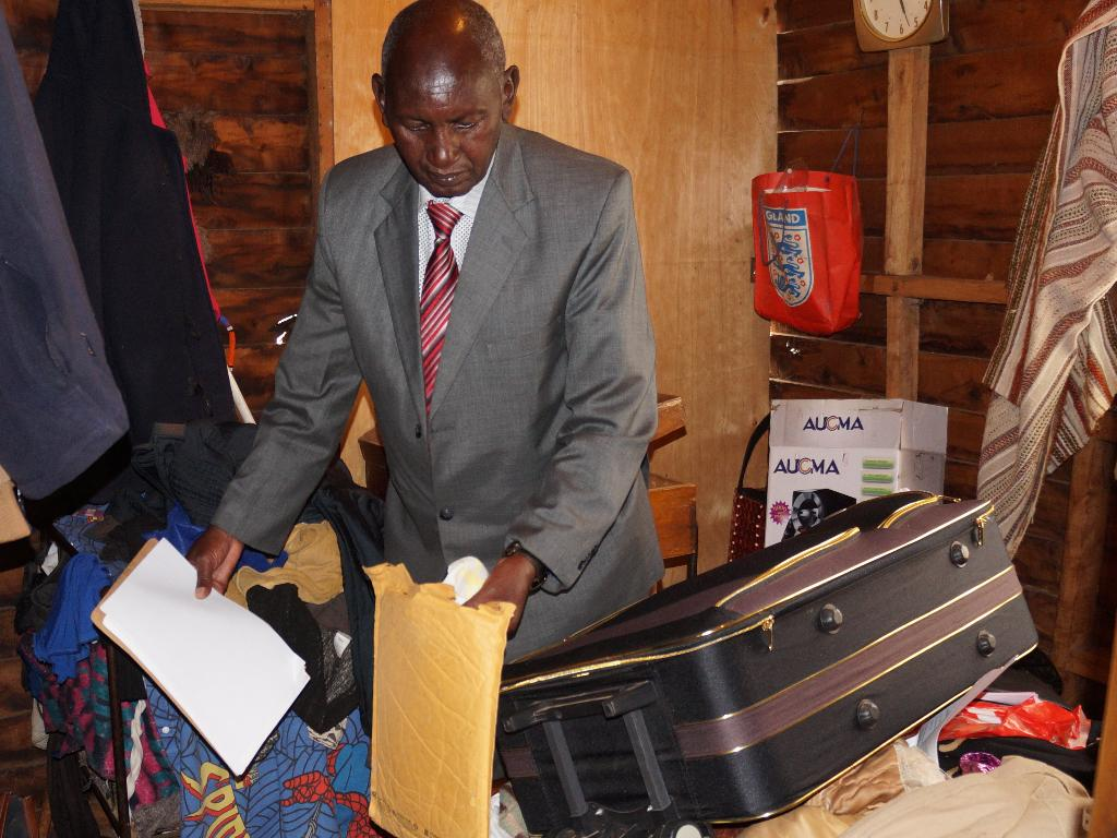 Peter Ndung'u showing how clothes, files with documents were ransacked in grandson's bedroom on Sunday afternoon.