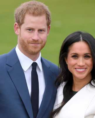 Meghan Markle standing with Prince Harry, plans to have her child born at home.photo credit:Commons Wikimedia