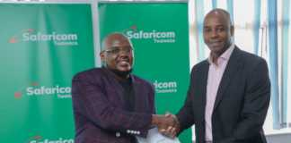 Safaricom Director Corporate Affairs, Steve Chege (right) and Genge Artist Hubert Nakitare (Nonini) shaking hands after signing an MOU of the partnership with Safaricom.