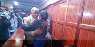 Jacque Maribe hugs Itumbi in court