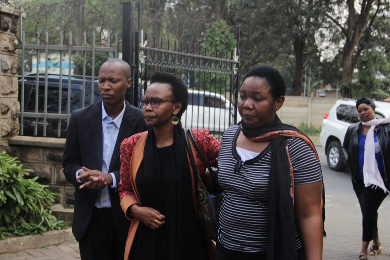 Mourners at Bob Collymore's mom