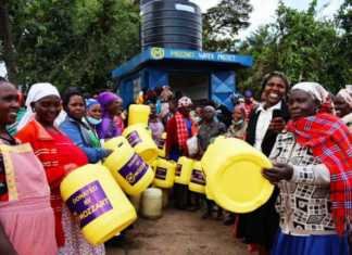 Residents of Chebunyo in Bomet excitedly line up at the brand new waterpoint commissioned by Mozzart