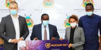 Elgeyo Marakwet County Governor Alex Tolgos H.E. Alex Tolgos receives dummy cheque from Mozzart for sh. 2 Million donation to Iten county referral hospital