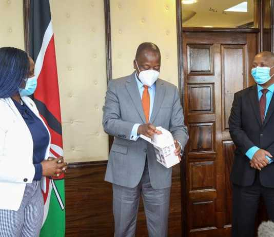 Cabinet Secretary, Ministry of Health, Hon. Mutahi Kagwe, EGH receives 12,000 K95 face masks and 2,000 disposable gowns from Nancy Matimu, Managing Director MultiChoice Kenya. The handover of the PPE was done at Afya House on Wednesday 21 April 2021